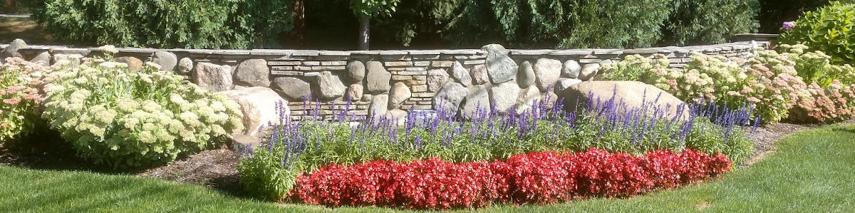 Flower bed condominium entrance with fully grown annuals